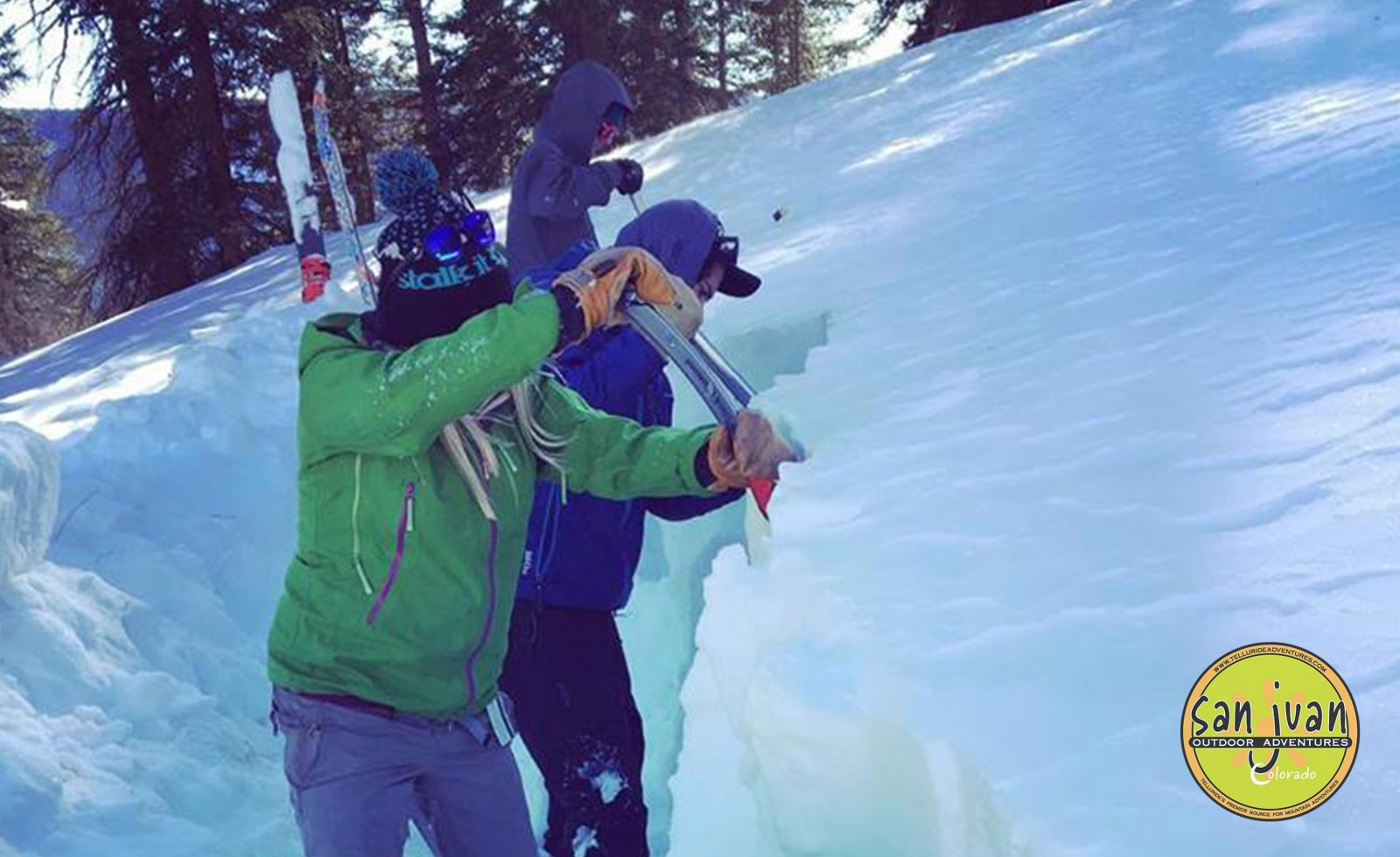 Avalanche Training students dig a snowsuit in Telluride Colorado